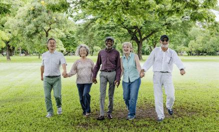 elderly people holding hands
