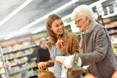 Elder woman with young woman at the grocery store
